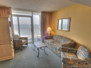Camelot by the Sea condo rental - living room with balcony overlooking the ocean