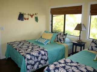 Princeville condo photo - Guest bedroom with 2 Queen beds and beautiful bamboo flooring - hear the ocean