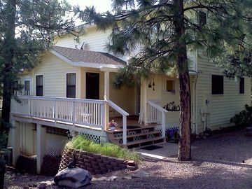 Pine cabin rental - front entry area has spacious parking, covered front deck,seating, easy steps.