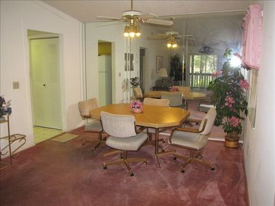 Dining area with glass wall, seats 4 - relax in your winter haven retreat
