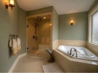 Kelowna house photo - Master Bath ensuite. Steam shower, soaker tub, & large walk in closet.