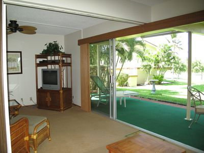 Large covered lanai just off the living area with breezes coming in the sliders.