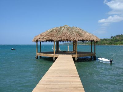 Palapa at the end of the pier from the sandy beach