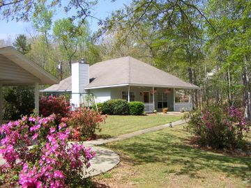 Lake Martin house rental - Side yard view of the house.