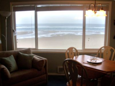 Sandy oceanfront is directly outside ~  Dine and relax while the surf pounds.