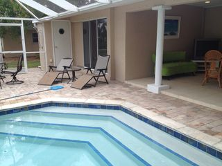 Cape Coral villa photo - Easy steps into pool, covered lanai, seating.
