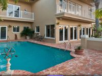 STUNNING WATERFRONT MANSION, WALK TO BEACH,5/5 FOR 12+ HEATED POOL ,LBTS