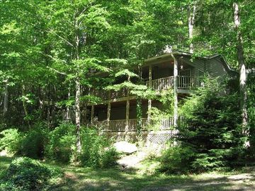 Lake Nantahala cabin rental - View of the exterior looking up from the creek.