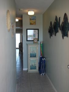 SeaCrest Condo Entrance with Beach Chairs, Umbrella and beach toys