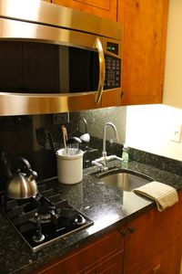 Marble countertops, stovetop, microwave, cooking utensils
