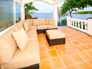 Spacious patio with resort-quality furniture, private plunge pool and views - Roatan villa vacation rental photo