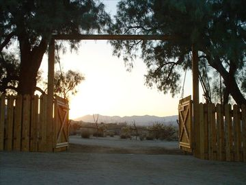 Joshua Tree cabin rental - The front gate, looking out to Big Bear Mountain.