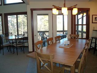 Massanutten house photo - Dining area, door to screened porch.