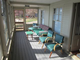 Sebago Lake Basin cabin photo - View from french doors to side door. Enclosed/screened porch. Lakefront.