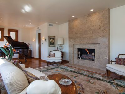 Main Living Area with Soaring ceilings and a Large Stone Fireplace