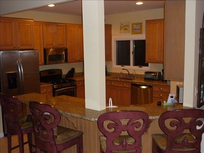 Modern Kitchen, side by side fridge, micr, dishwasher , granite counter seats 4