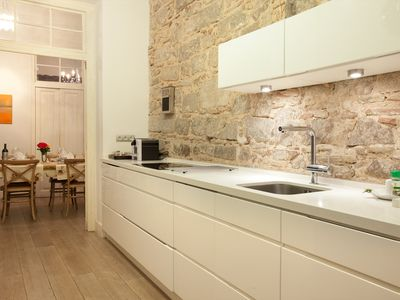 Kitchen with exposed stone walls