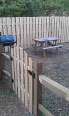 Oak Island house photo - The fenced in backyard and a charcoal grill for your use