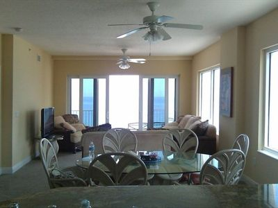 Living room , dining room ....with fans and amazing ocean views of-course.