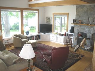 Freeport house photo - Spacious living room with wide screen TV and fireplace