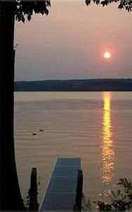 Sunset view showing dock and looking across Lake Leelanau.