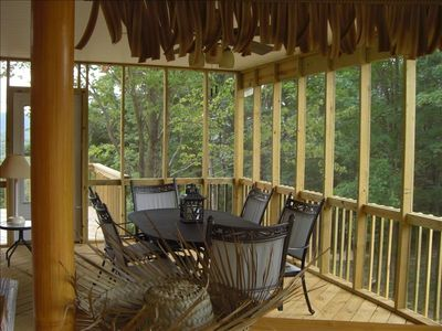 Large screened-in porch with tiki bar