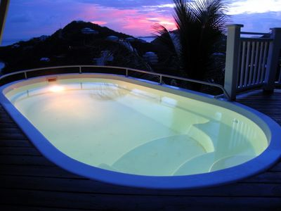 Sip your sunset cocktail while soaking in the pool