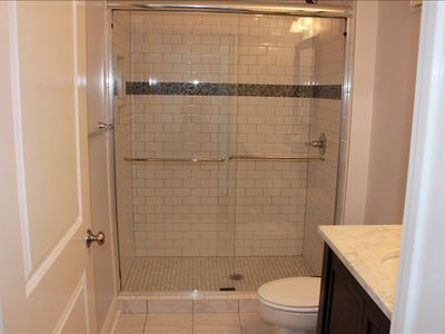 All new bathroom - walk in shower with glass tile border and marble countertops
