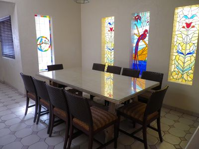 We have stained glass windows in the dining room and a table for 12 people