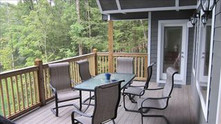La Follette cabin photo - Covered deck with spectacular views