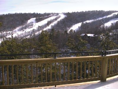 View of ski slopes from the upper deck - watch skiers and snowboarders come down