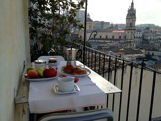 Modica house photo - Breakfast with traditional sweets and chocolate of Modica