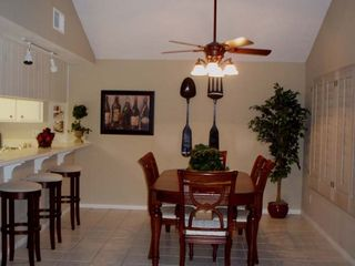 Dining room with seating for 6 plus 3 bar stools - Palm Desert condo vacation rental photo