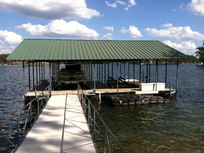 boat dock with two covered slips and a jet dock.