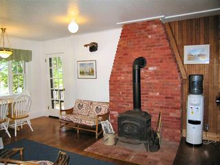 Wolfeboro cottage photo - Wood stove in the Kitchen/ Family area