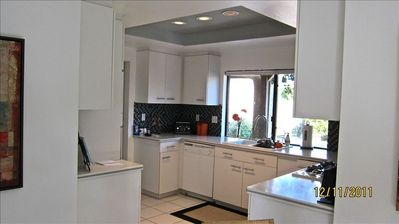 Designer  Kitchen with Corian Counter Tops / Sea Glass Tile Back Splash