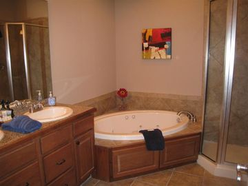 Master has whirlpool tub for two, double vanities and walk in shower.