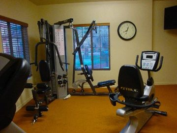 Downstairs fitness room opposite pool and courtyard