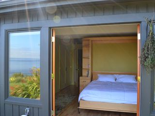 Bainbridge Island house photo - reflections of the ocean through this window. King size bed and French Doors.