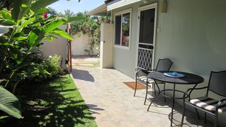 Kihei cottage photo - Private entrance with parking, retractable awning for shade above table.