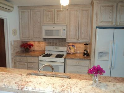 New beautiful kitchen, with marble countertops.