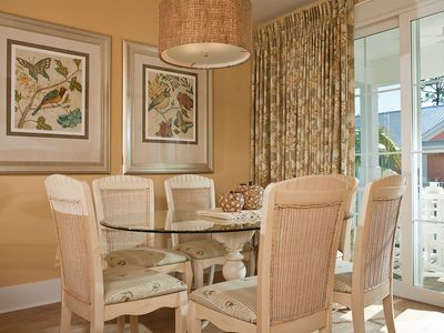 Quaint Dining Area with balcony view.