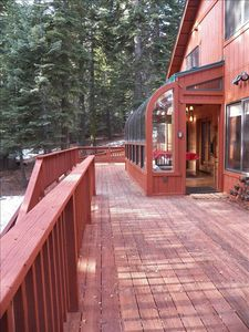Huge decks and sunroom make this a great spot winter or summer.