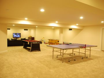 "Game Room Paradise in the basement. Ping pong, pool table, foosball and 51"" TV."