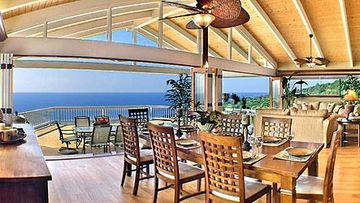 Captain Cook chateau / country house rental - Indoor Dining with views out the 40' french folding doors to the ocean