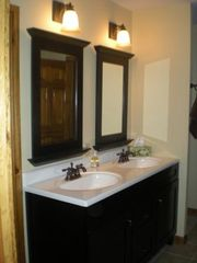 Londonderry house photo - Master bath vanity includes a jet tub and walk-in shower.
