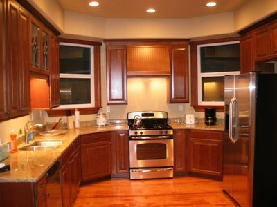 Modern, gourmet Kitchen with cherry cabinets, granite countertops and stainless