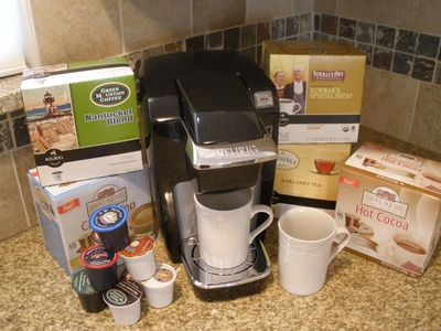 Keurig coffee maker with a selection of hot beverages; reg drip coffee maker too