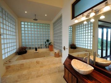 The Master Bedroom Bathtup/Shower is Luxurious