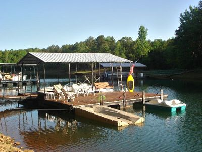 Single-slip Covered Dock with Expanded Sitting Area, Swing and Jetski Platform